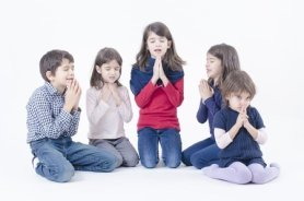 Group of children praying